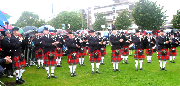 FMM line up in the rain at Glasgow Green