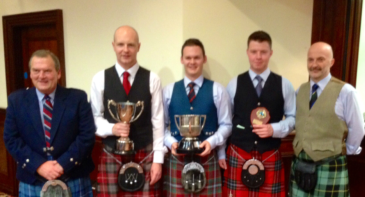 Adjudicator Len Brown, champion pipers Ashley McMichael, Graham Drummond and Ross Hume, adjudicator Robert Wallace