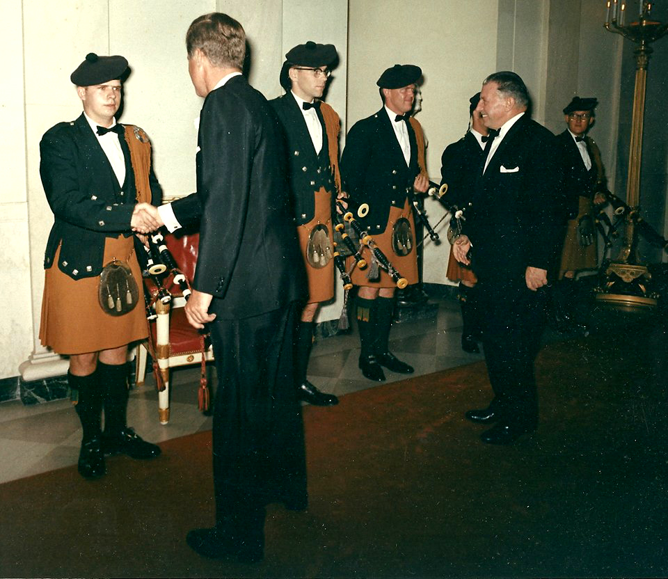 (Left to right): Robert Fulton shaking hands with the President, Jerry Cashion and Tom Kirkpatrick; Drummer John Bosworth, behind Prime Minister Sean LeMass; and Sandy Jones (15 Oct., 1963)