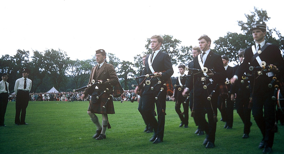 The 214 BB going on to the field at the World Pipe Band Championships at Inverness in 1966. Personnel are l to r: P/M Alex MacIver, Archie MacLean (just visible), Alasdair Ross, Robert Wallace, Hughie MacPhail, Finlay Drynan, John Morrison, Kenny Cape