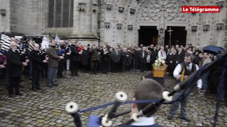 Crowd and pipers at Erwan's funeral