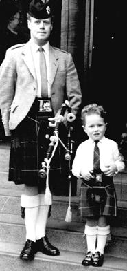 With father Norman...a first picture of Alasdair in a kilt